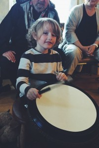Wisdom child banging drum